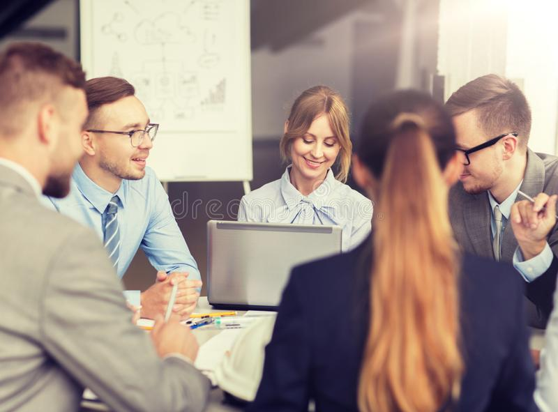 Architects with laptop meeting at office royalty free stock images