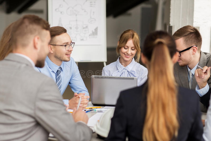 Architects with laptop meeting at office stock photography