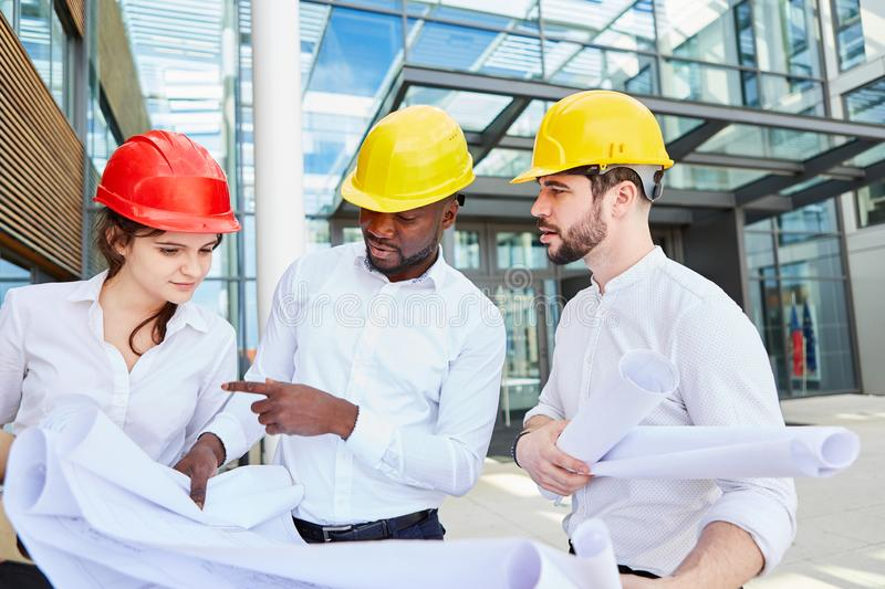 Architects make project planning as a team stock image