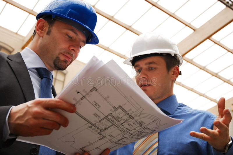 Architects Reviewing Blueprint royalty free stock image