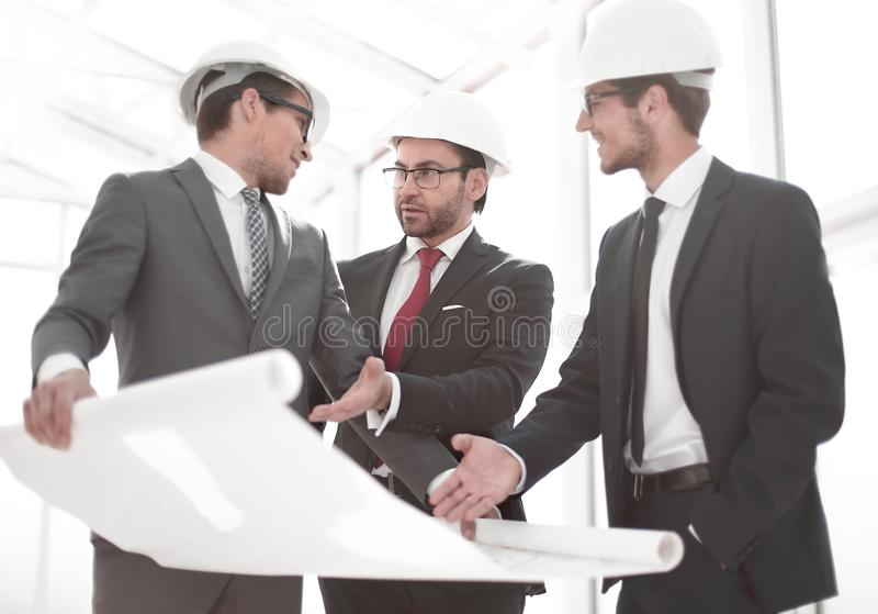 Architects show the client a new design project stock photo