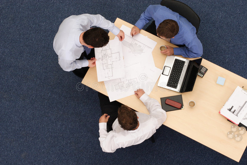 Download Architects Talking About Blueprints Stock Photo - Image: 3606810