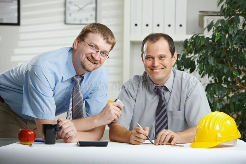 Architects talking at office stock images