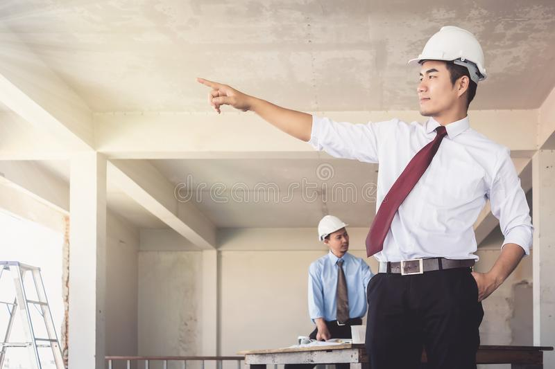 Architects who are standing are pointing their hands at building royalty free stock photo