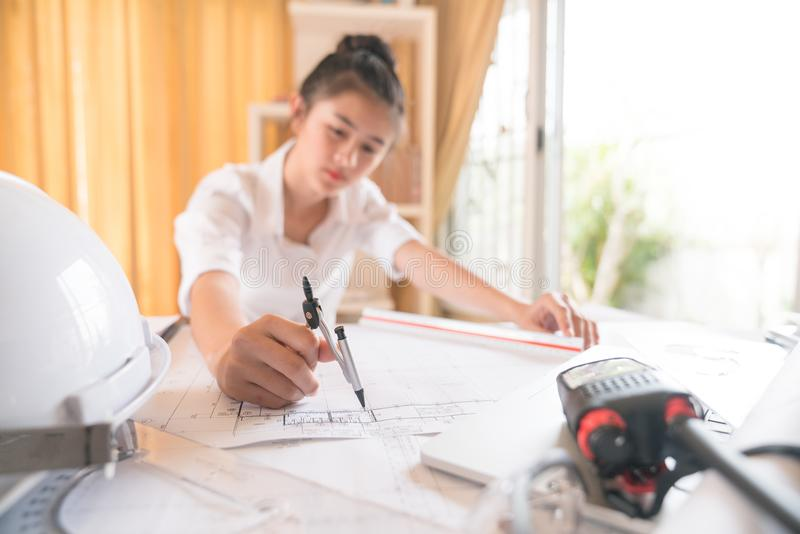 Architects who work on blueprints to work in-house architectural. Blueprints, rulers, calculators, laptops and compass. Engineering Tools Select Focus royalty free stock photo