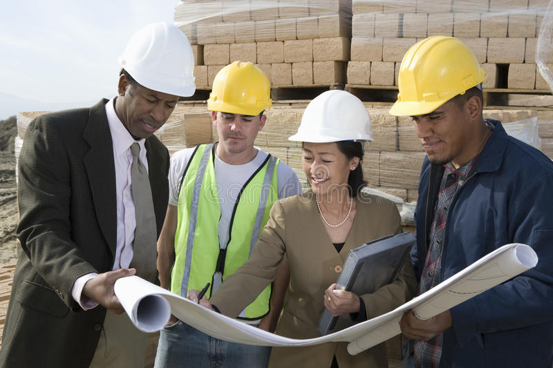 Download Architects And Workers In Discussion At Site Stock Image - Image of foreman, outdoors: 29652663