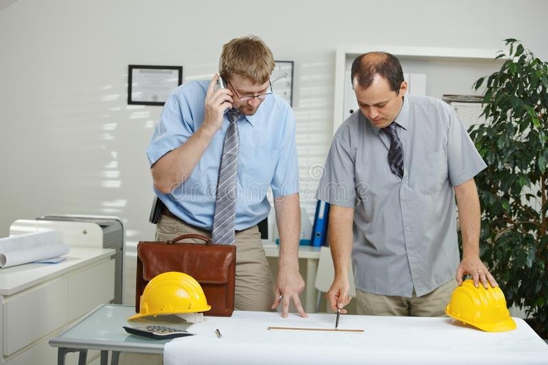 Architects working at desk stock image