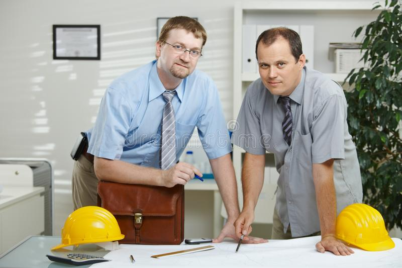 Architects working at office royalty free stock photo