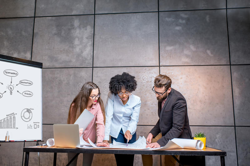 Architects working at the office stock photography