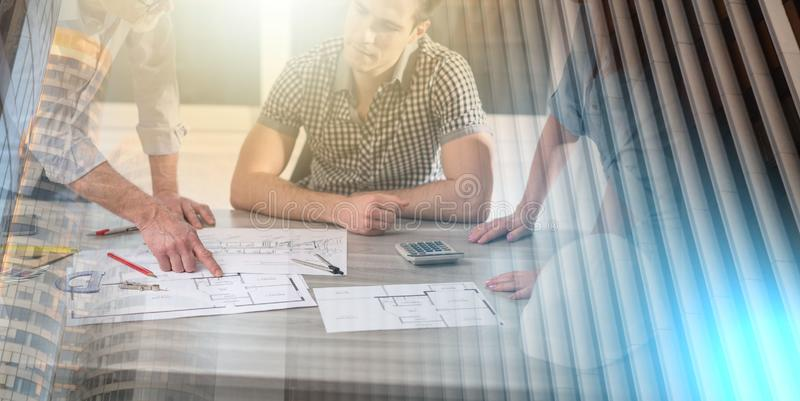 Architects working on plans; multiple exposure stock photo