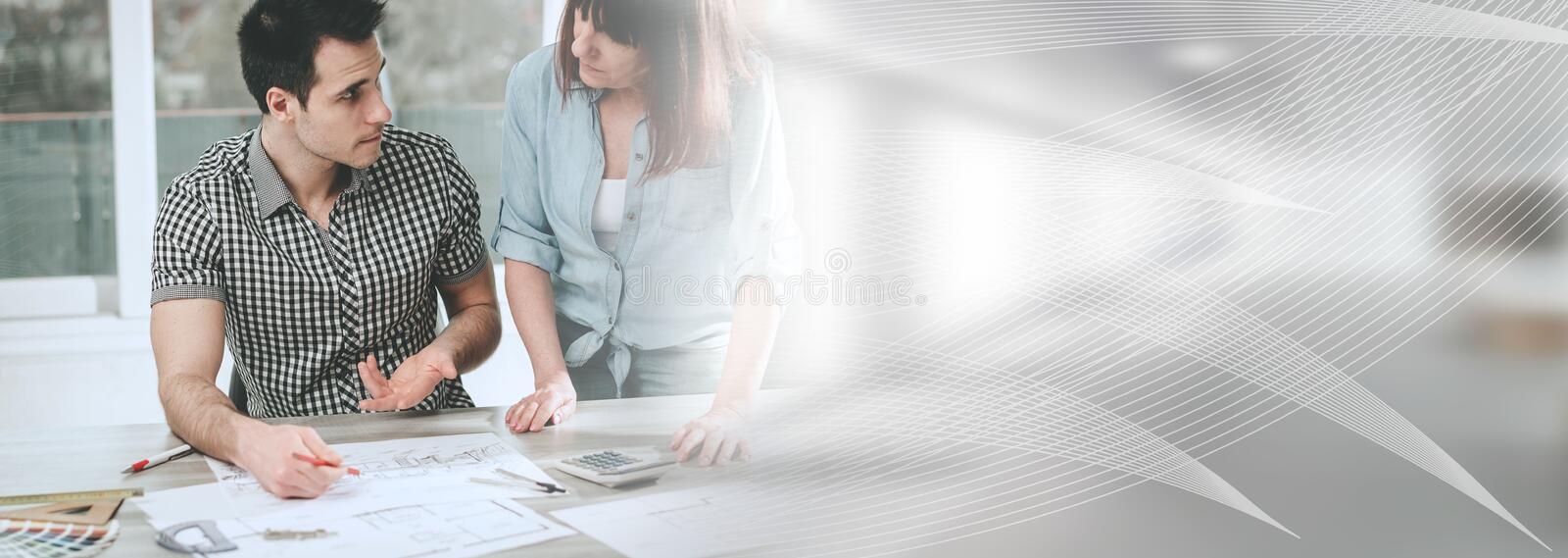 Architects working on plans; panoramic banner royalty free stock image