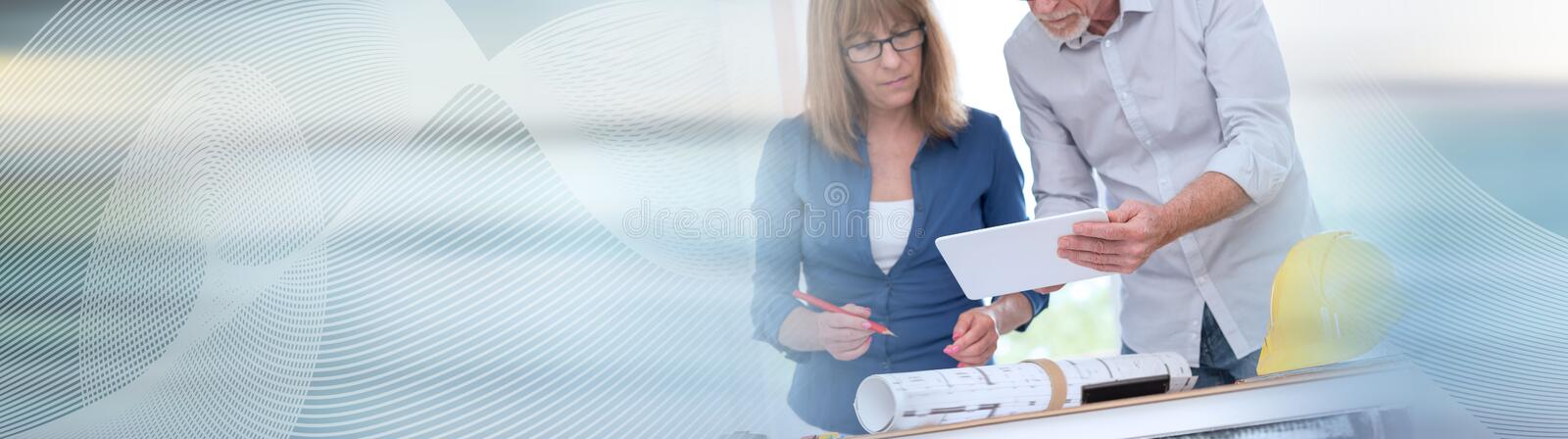 Architects working on plans; panoramic banner royalty free stock images