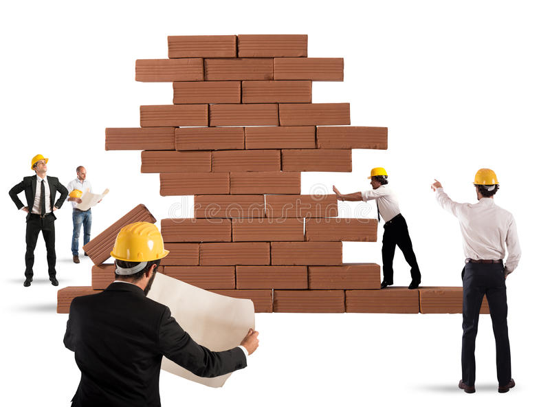 Architects working on a project. Team of architects working and analyzing on a bricks construction project stock images