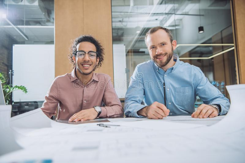 architects working on project together stock photos