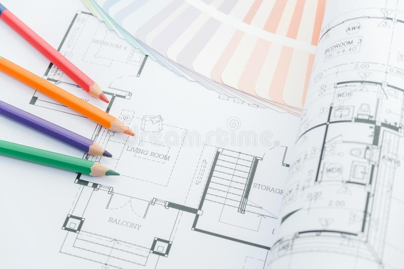 Architects workplace - architectural drawings of the modern house with color pencils and sample colors. decoration concept. stock photos