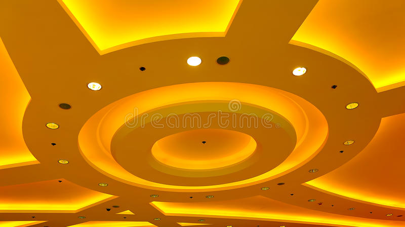 Architectural abstract ceiling light fixture. Unique, abstract shapes of the light fixtures of a modern building ceiling stock photography