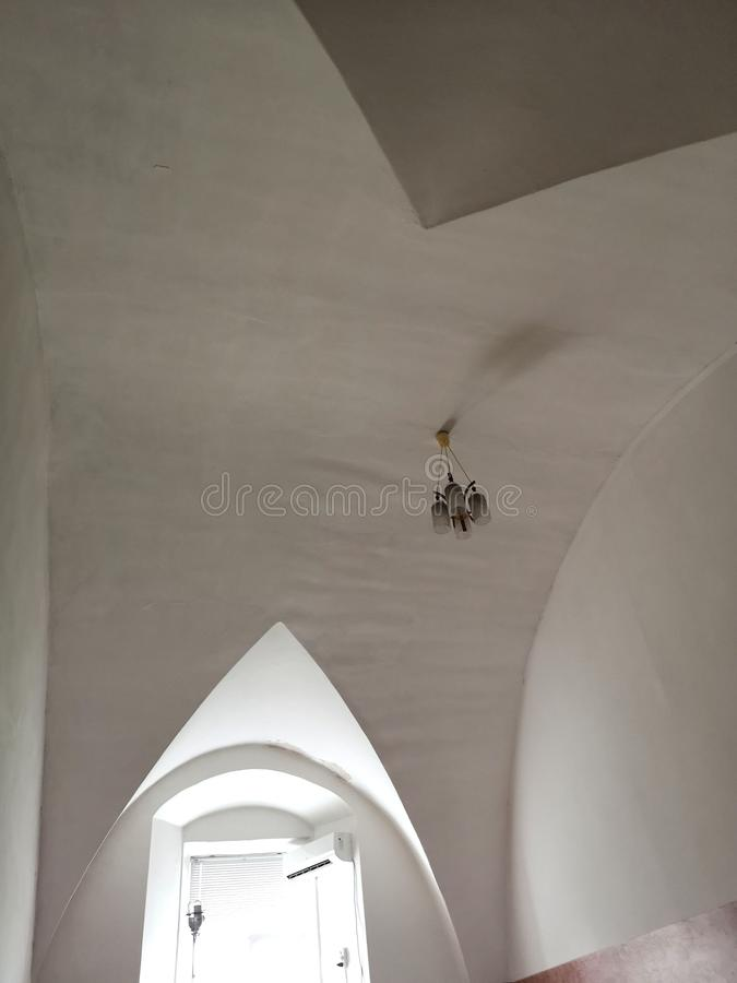 Architectural background. Modern white concrete arched ceiling in perspective. semicircular shape. Photo, architecture, design, building, light, structure royalty free stock image