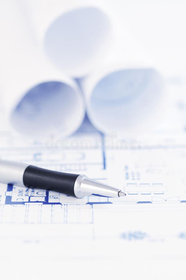 Architectural blueprint with pen stock photos