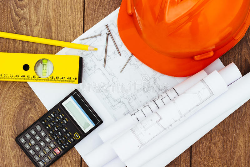 Architectural blueprints and blueprint rolls stock images