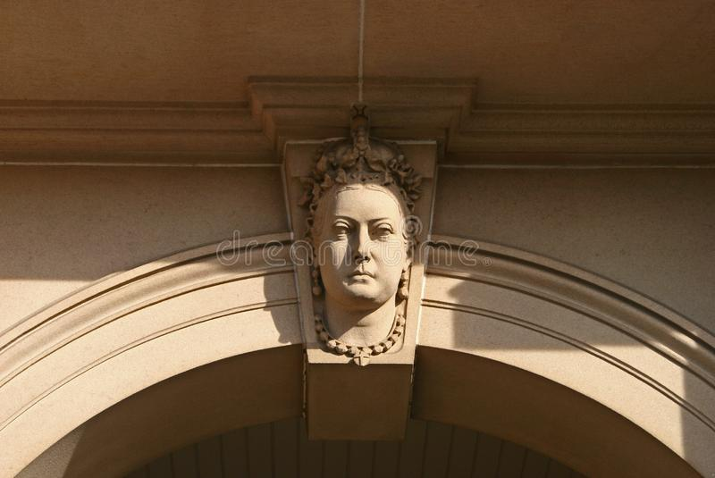 Beige arch keystone of sculpted rock Queen Victoria head relief on historic Custom House, Circular Quay, Sydney, NSW, Australia stock image