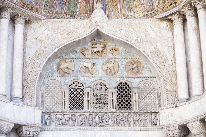 Architectural decoration on the facade of San Marco Cathedral in Venice stock photography
