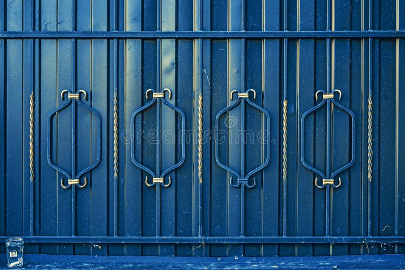 Architectural decorative exterior metal fence. Metal gates, forged pattern royalty free stock photo