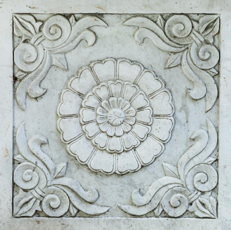 Architectural Detail Carved into Grey Marble: Scrolls and Chrysanthemum Flower royalty free stock photo