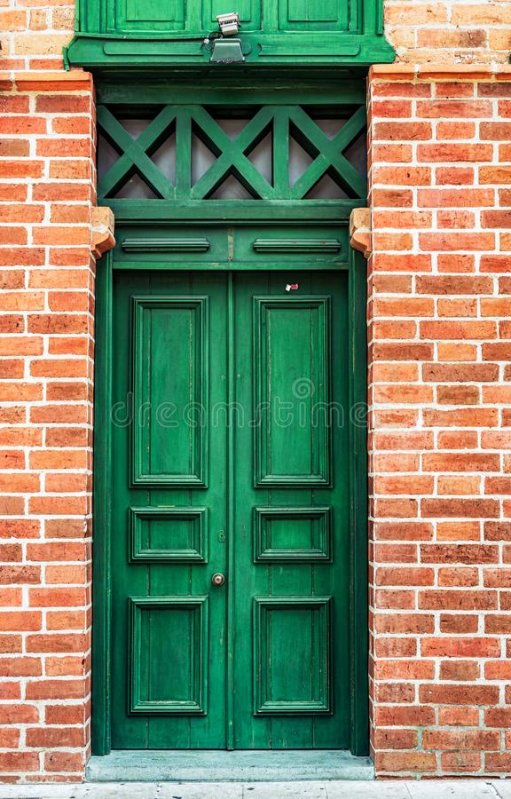 Entrance door, to picturesque colonial house in Medellin, Colombia. Architectural detail , entrance door, to picturesque colonial house in Medellin, Colombia stock image