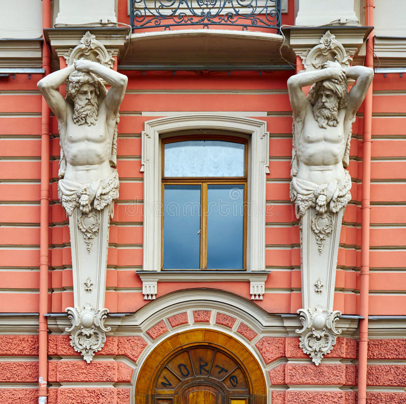Architectural detail of facade in neo-Baroque style with figures of Atlantes. Architectural detail of the facade in neo-Baroque style with figures of Atlantes stock photos
