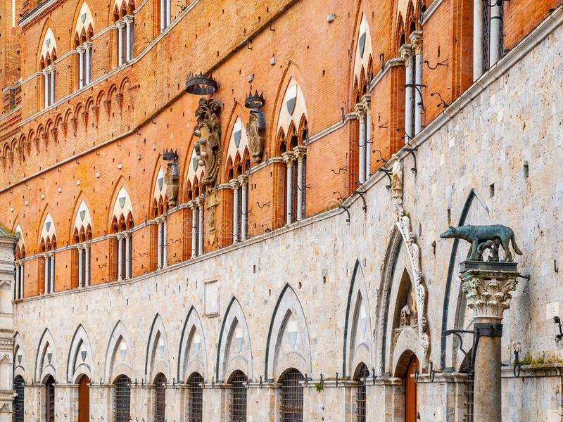 Architectural detail of front facade of Siena Town Hall, Palazzo Pubblico, at the Piazza del Campo, Tuscany, Italy royalty free stock photo