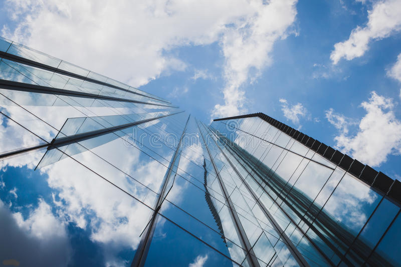 Architectural detail of a modern building. Against blue sky with clouds royalty free stock photos