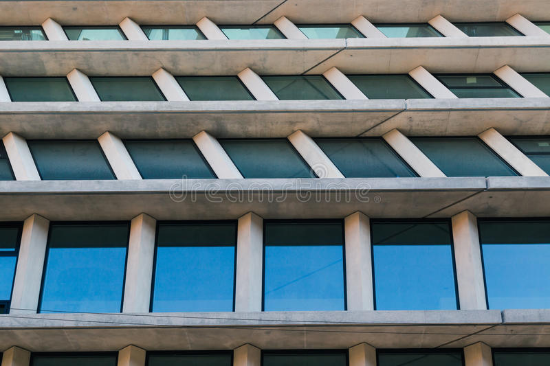 Architectural detail of a modern building. Architectural detail of a concrete modern building with windows royalty free stock photos