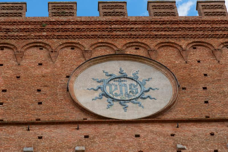 Architectural detail of the Palazzo Pubblico at the Piazza del Campo in Siena, Italy, Europe.  stock images