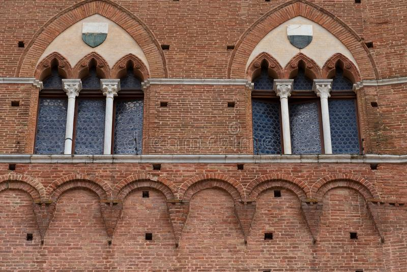Architectural detail of the Palazzo Pubblico at the Piazza del Campo in Siena, Italy, Europe.  stock photography
