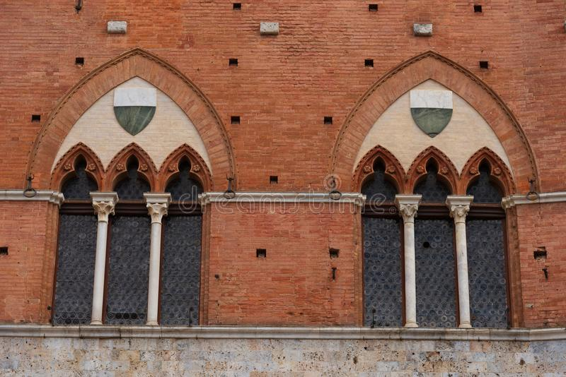 Architectural detail of the Palazzo Pubblico at the Piazza del Campo in Siena, Italy, Europe.  royalty free stock images
