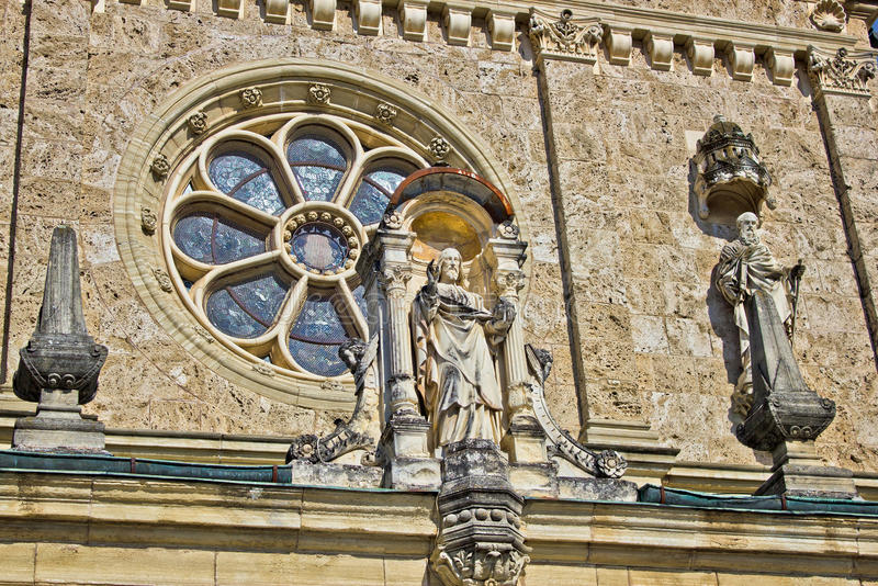 Architectural detail - window and saint statue stock image