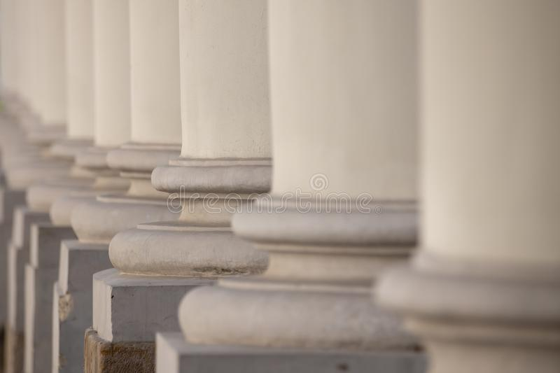 Architectural details of the building. Row of white columns stock photo