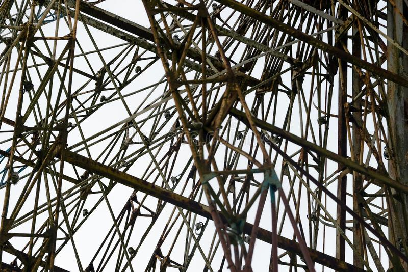 Architectural details of the metallic structure of a big ferris wheel. Old, rustic carousel details at circus outdoor.  royalty free stock photography
