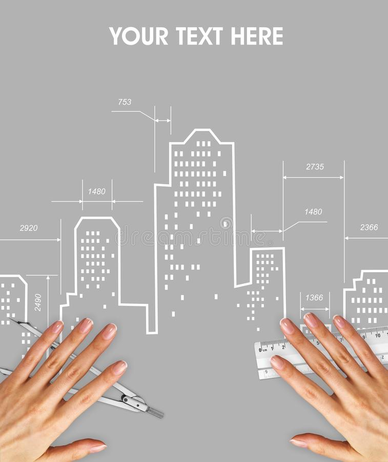 Architectural drawing of skyscrapers on light gray background. Above drawing are hands with a ruler and a compass. Modern city or the modern district is not stock image