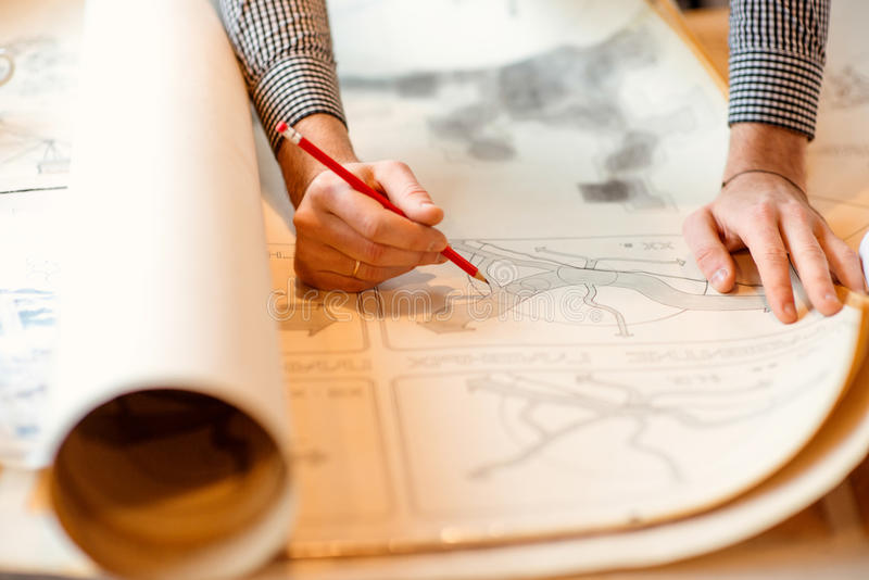 Architectural drawings. Projecting with pencil on the big urban drawings. Town planning stock image