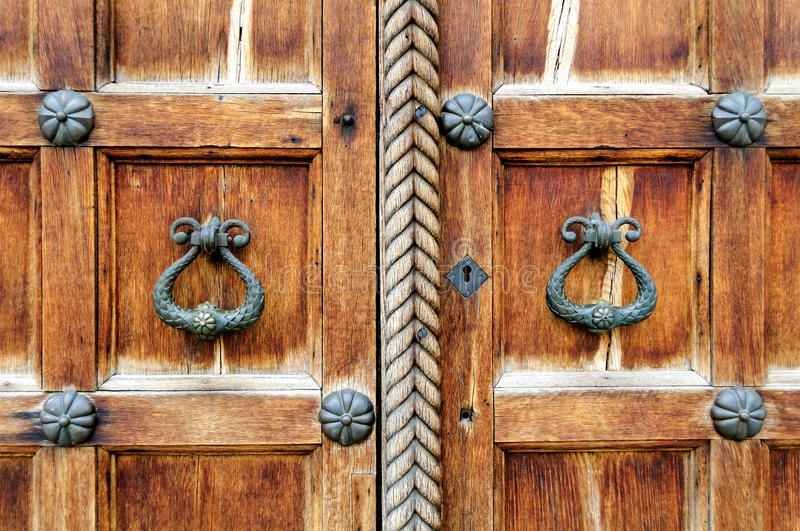 Architectural elements of St. Sophia Cathedral doors in Veliky Novgorod. Metal locks on the background of the old wooden texture royalty free stock photography