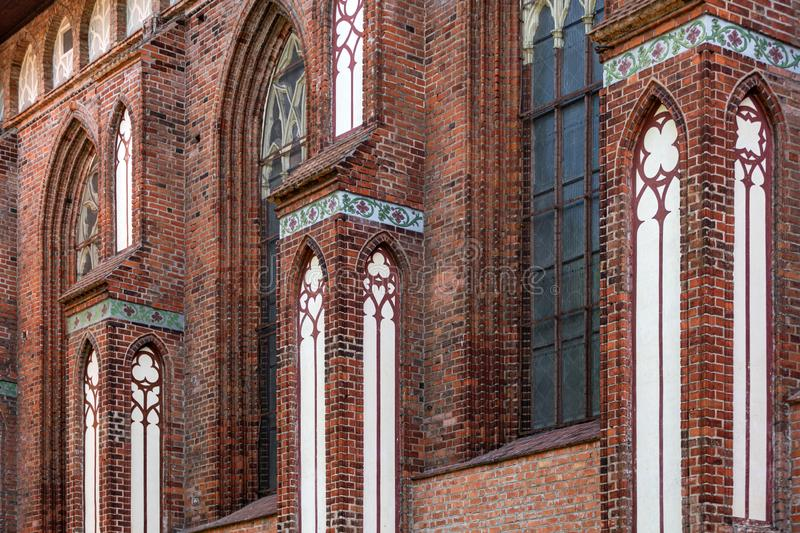 Architectural elements, vaults and windows of gothic cathedral. Red Brick walls. Kaliningrad, Russia. Immanuel Kant island stock photos
