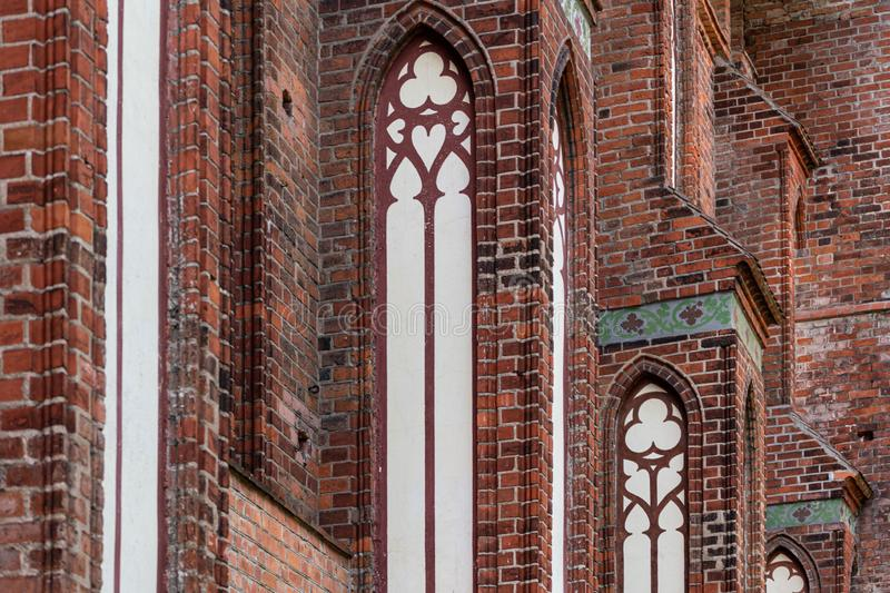 Architectural elements, vaults and windows of gothic cathedral. Red Brick walls. Kaliningrad, Russia. Immanuel Kant island royalty free stock photos