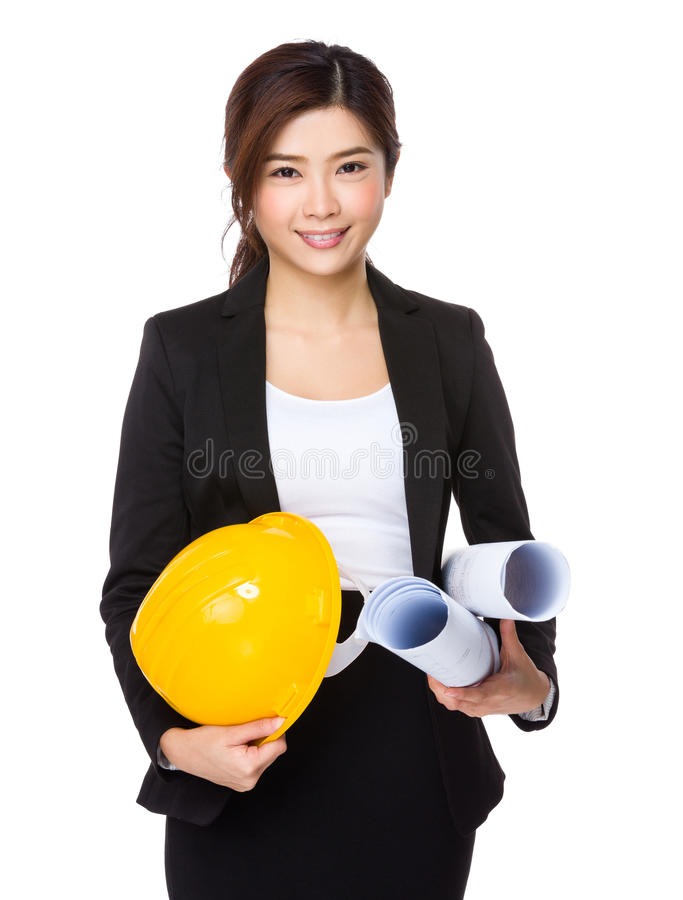 Architectural engineer with yellow protective hat and blue print stock photography