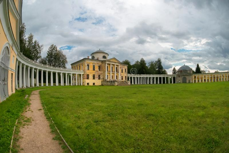 Architectural ensemble - The manor house and the circular colonnade. Architectural ensemble Manor Znamenskoye-Rayok. The manor house and the circular colonnade stock photography