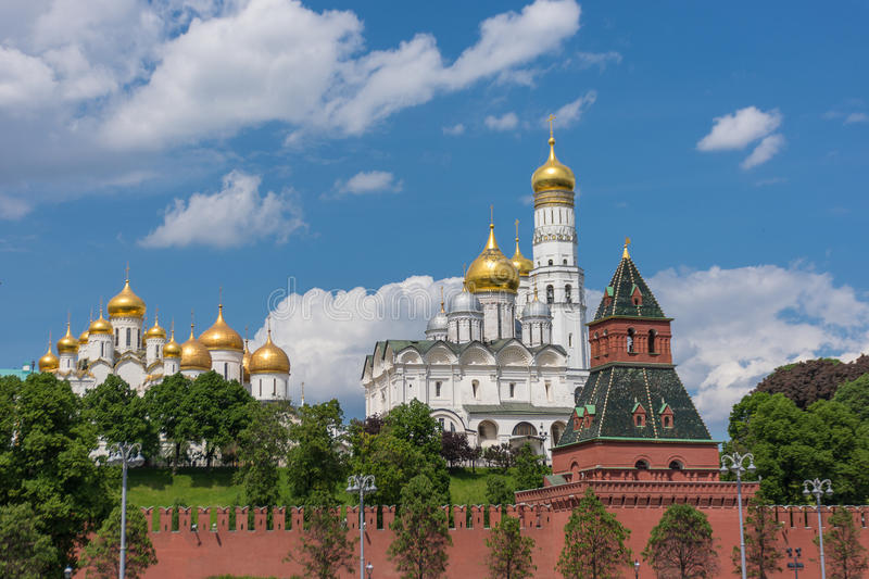 Architectural ensemble of Moscow Kremlin from Sofiyskaya embankment of Moskva River with beautiful kremlin churches and Taynitskay stock images