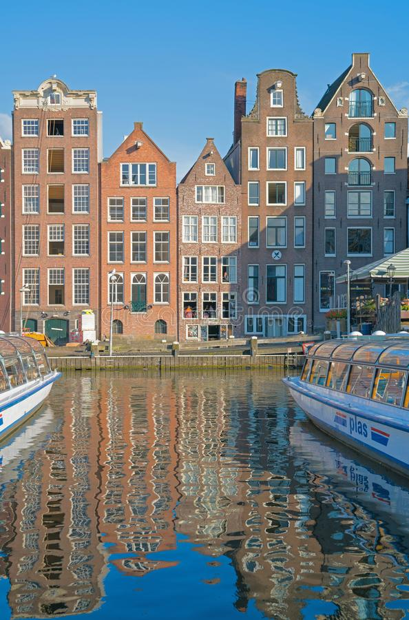 Architectural facades of a range of styles for which the city is. AMSTERDAM, HOLLAND - AUGUST 19, 2017; Four of different architectural facades styles for which royalty free stock images
