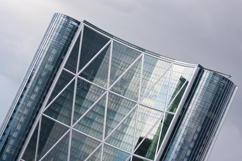 Architectural Geometry. Steel and glass office tower displaying the geometry of triangles and diamonds royalty free stock images