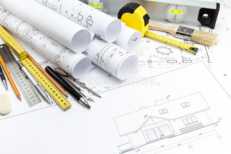 Architectural house plans and work tools royalty free stock photos