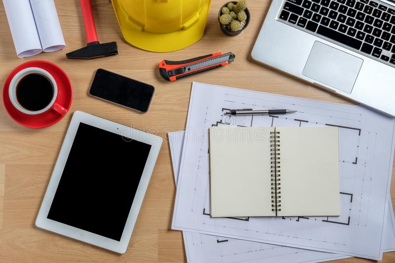 Architectural office desk with laptop. Smart phone,tablet,cup of coffee and engineer equipment.Top view background construcion project idea concept stock images